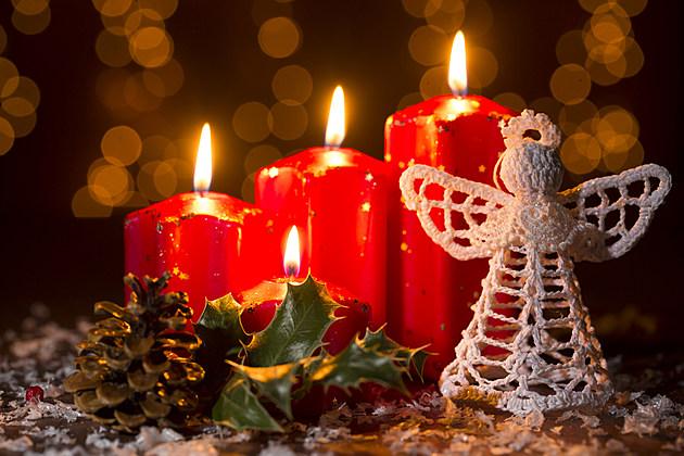 crochet angel on snowy wooden