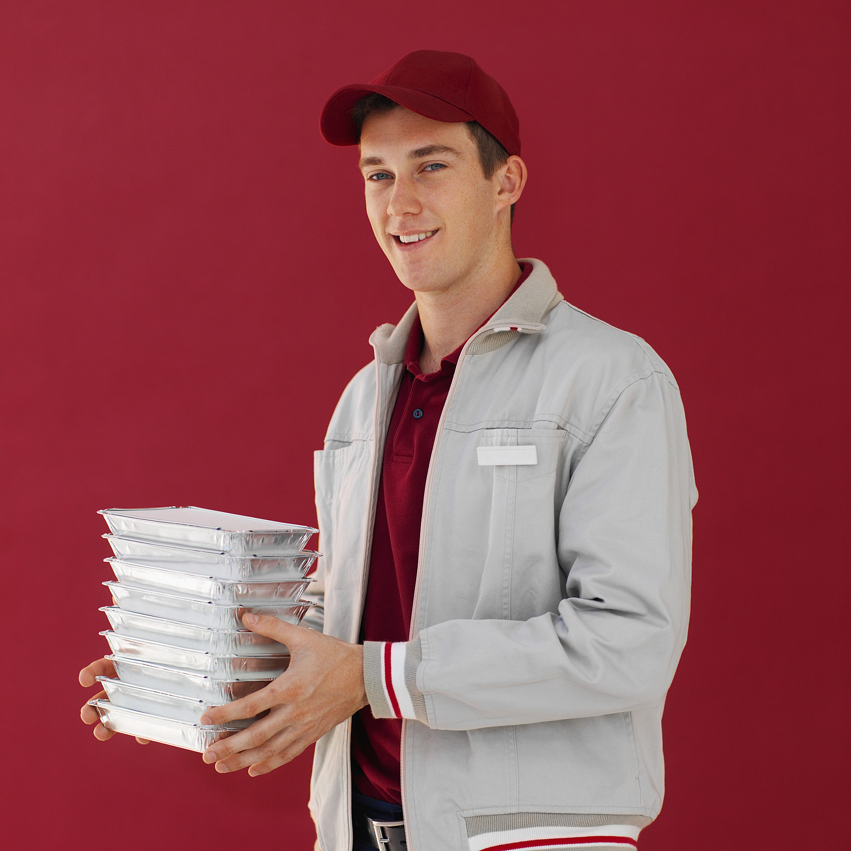Close-up of delivery man holding fast-food